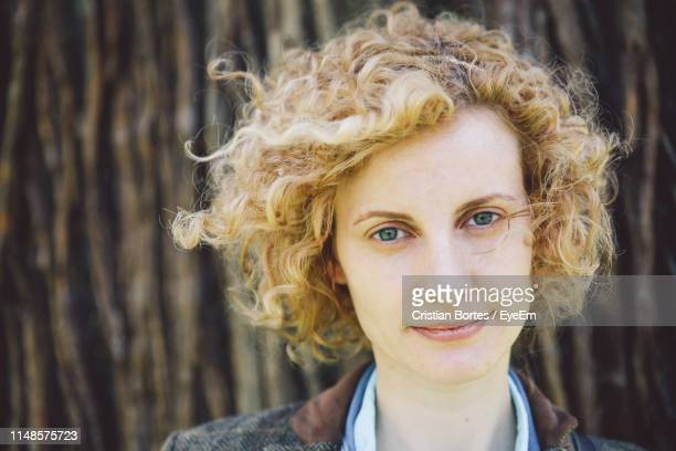 portrait of beautiful woman with short blond hair outdoors - bortes foto e immagini stock