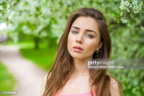 Portrait Of Beautiful Young Brunette Woman In Spring Blossom