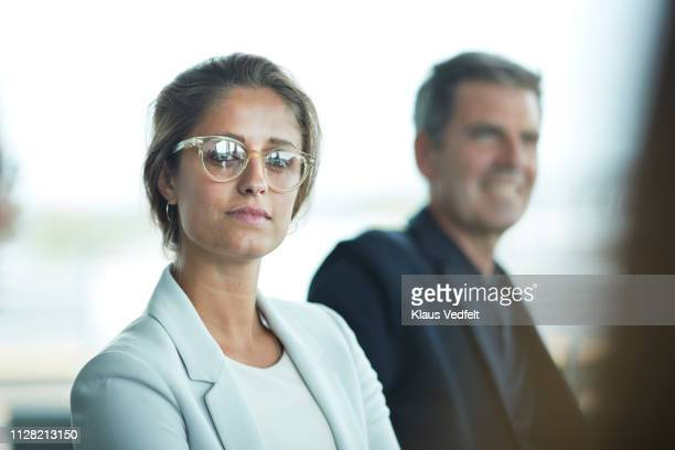 portrait of beautiful young businesswoman in meeting room - businesswear stock pictures, royalty-free photos & images