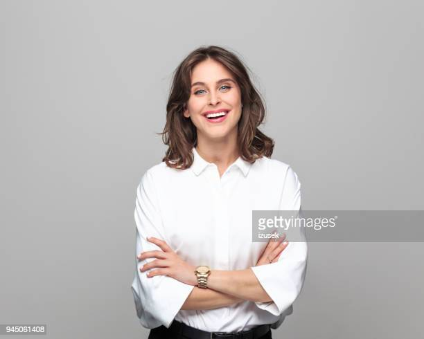 portrait of beautiful young businesswoman - studio shot stock pictures, royalty-free photos & images