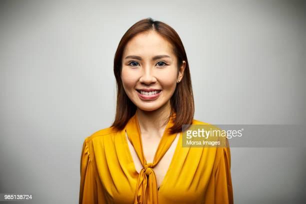 portrait of beautiful young businesswoman smiling - ビジネスウェア ストックフォトと画像