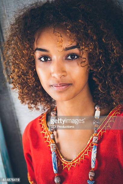 portrait of beautiful young ethiopian woman in traditional clothing - beautiful ethiopian girls stock photos and pictures