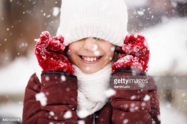 Portrait of beautiful young girl enjoying winter outdoors