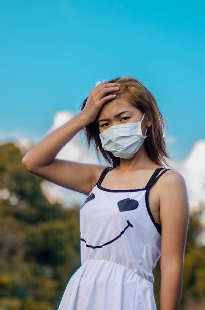 Portrait Of Beautiful Young Woman Against Blue Sky