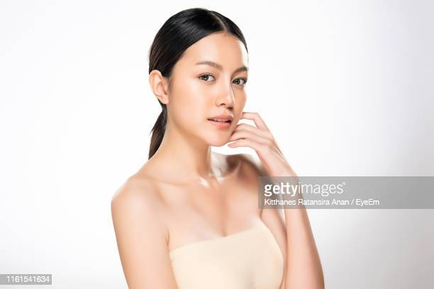 Portrait Of Beautiful Young Woman Against White Background