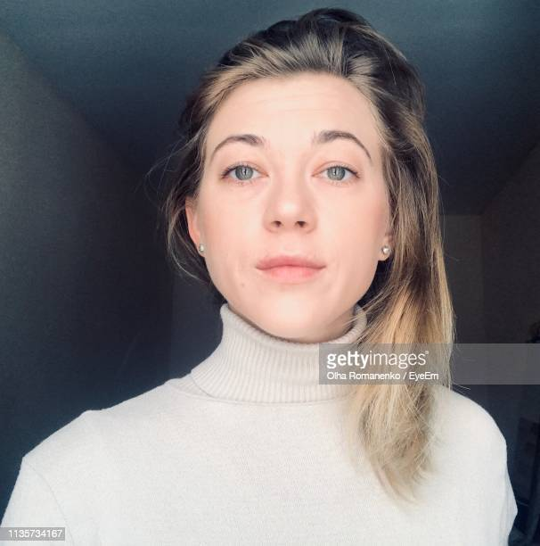 portrait of beautiful young woman at home - polo neck stock pictures, royalty-free photos & images