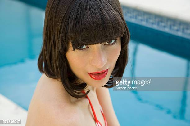 portrait of beautiful young woman at swimming pool