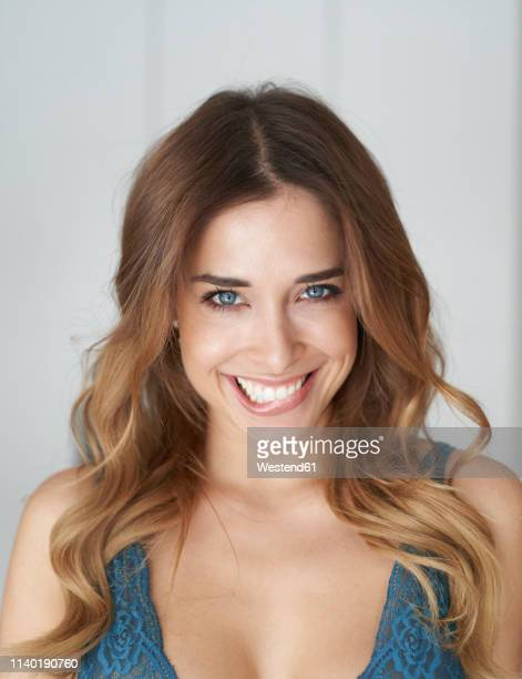 portrait of beautiful young woman biting on lip - hot girls stock pictures, royalty-free photos & images