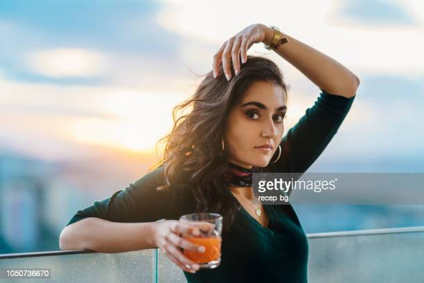 portrait of beautiful young woman during sunset - central anatolia stock photos and pictures