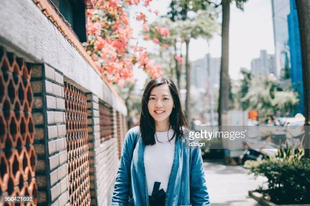 portrait of beautiful young woman exploring local street in city - 台北市 ストックフォトと画像