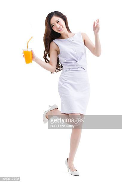 Portrait of beautiful young woman holding a cup of juice