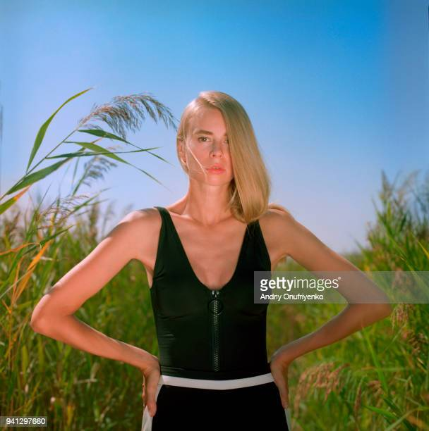 Portrait of beautiful young woman in a tall grass