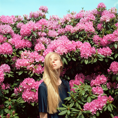 Portrait of beautiful young woman in flowers - gettyimageskorea