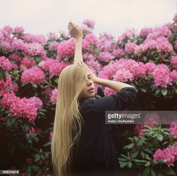 Portrait of beautiful young woman in flowers