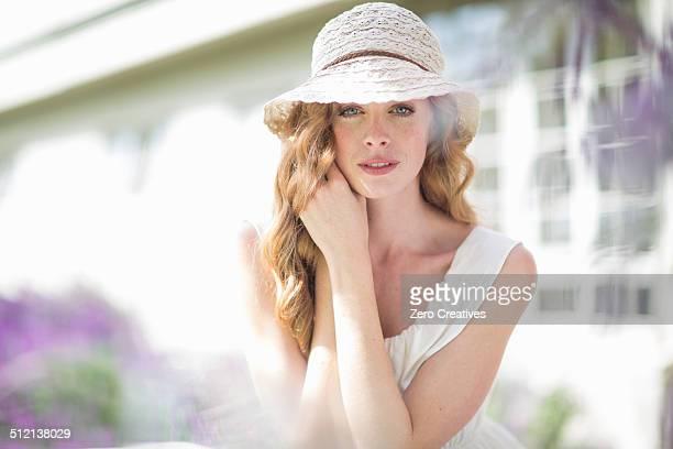 Portrait of beautiful young woman in garden