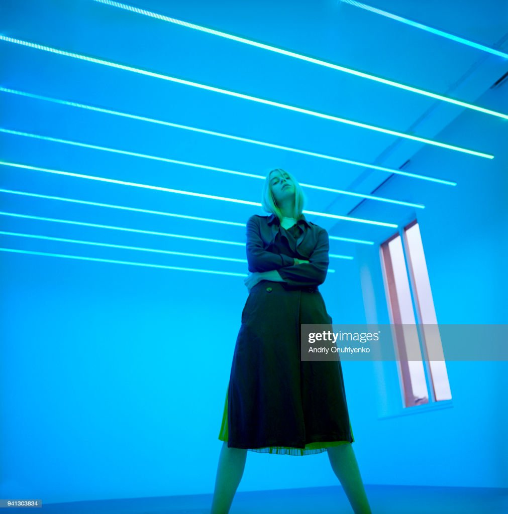 Portrait of beautiful young woman in neon light : Stock Photo