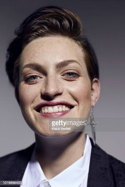 portrait of beautiful young woman laughing, shot on studio - veste noire photos et images de collection
