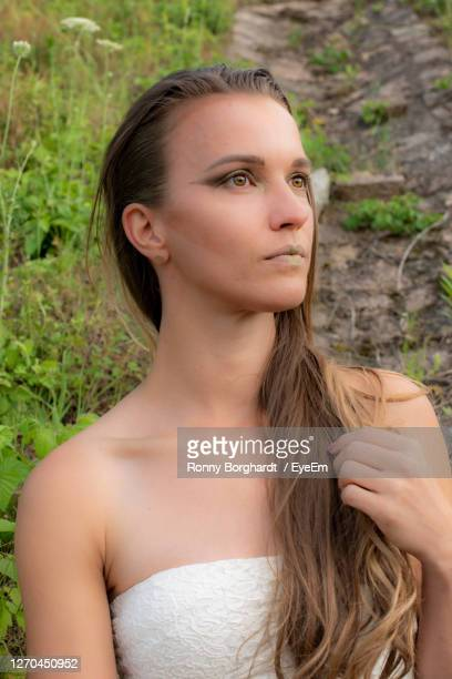 portrait of beautiful young woman look away - strapless dress stock pictures, royalty-free photos & images