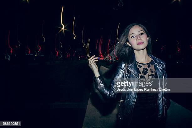 Portrait Of Beautiful Young Woman On Street At Night