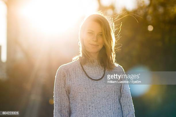 Portrait Of Beautiful Young Woman On Sunny Day