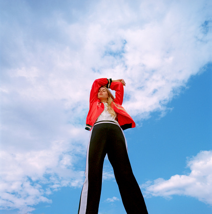 Portrait of beautiful young woman over blue sky - gettyimageskorea