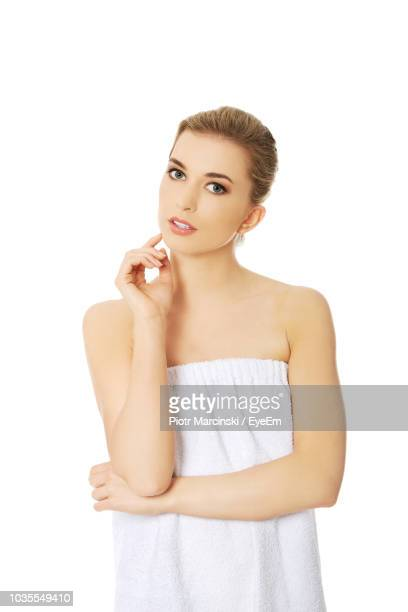 portrait of beautiful young woman over white background - ストラップレス ストックフォトと画像