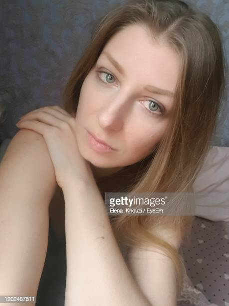 portrait of beautiful young woman - elena knouzi stock pictures, royalty-free photos & images