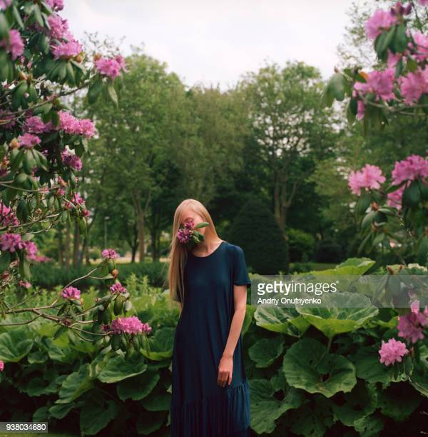 Portrait of beautiful young woman relaxing in meadow