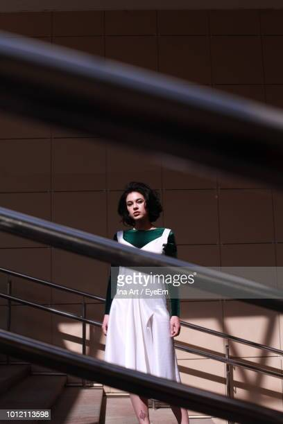Portrait Of Beautiful Young Woman Standing On Steps
