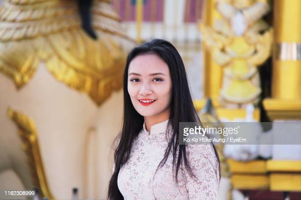 portrait of beautiful young woman standing outdoors - ko ko htike aung stock pictures, royalty-free photos & images