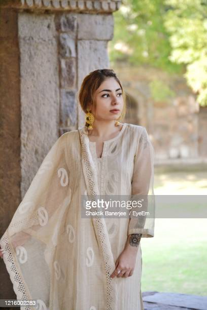portrait of beautiful young woman standing outdoors - catwalk stock pictures, royalty-free photos & images