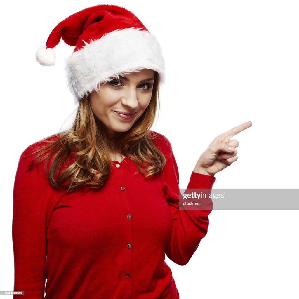 Portrait of beautiful young woman wearing a santa hat : Stock Photo