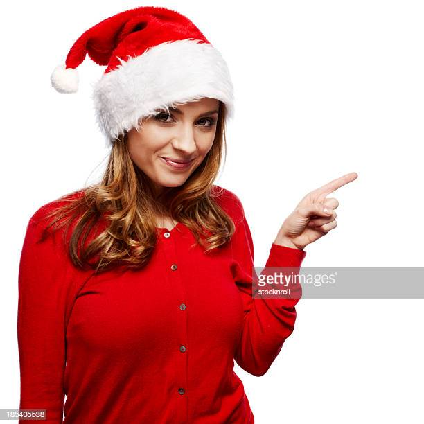 portrait of beautiful young woman wearing a santa hat - santa face stock photos and pictures