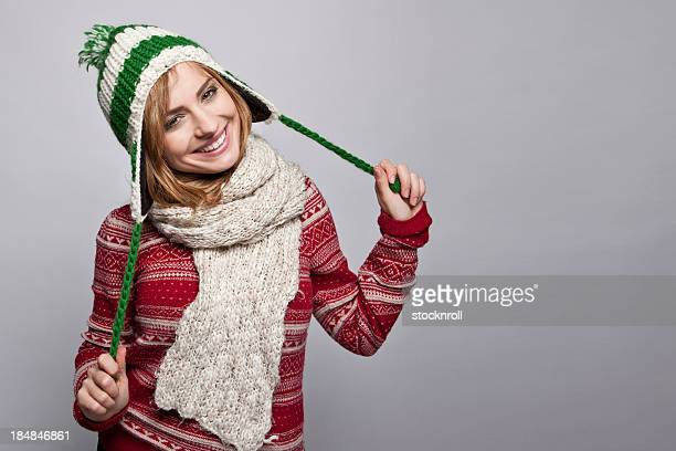 Portrait of beautiful young woman wearing a wooly hat.