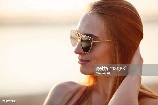 Portrait of beautiful young woman wearing sunglasses