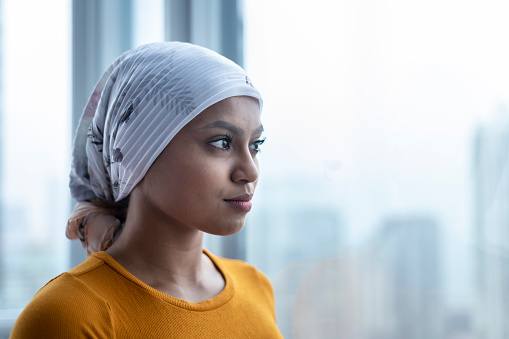 Portrait of beautiful young ethnic woman with cancer 1141776219