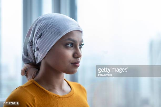 portrait of beautiful young woman with cancer - breast cancer stock pictures, royalty-free photos & images