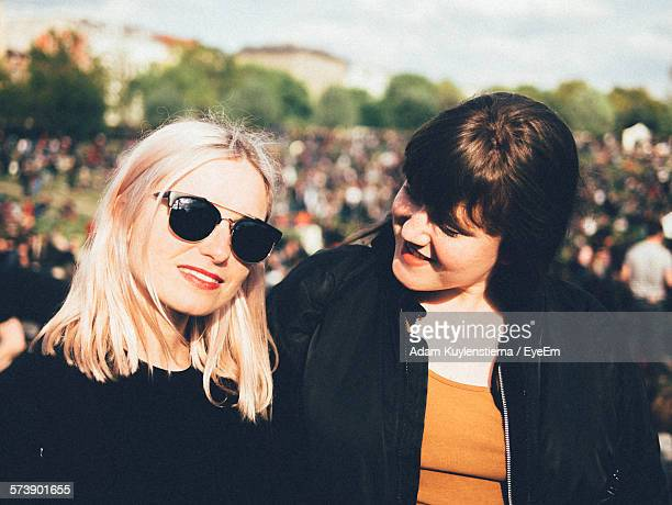 Portrait Of Beautiful Young Woman With Friend In Park