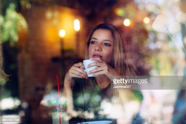 Portrait of  beautiful young women sitting at the cafe