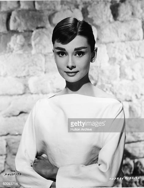 Portrait of Belgianborn American actress Audrey Hepburn ina white longsleeved dress mid 1950s