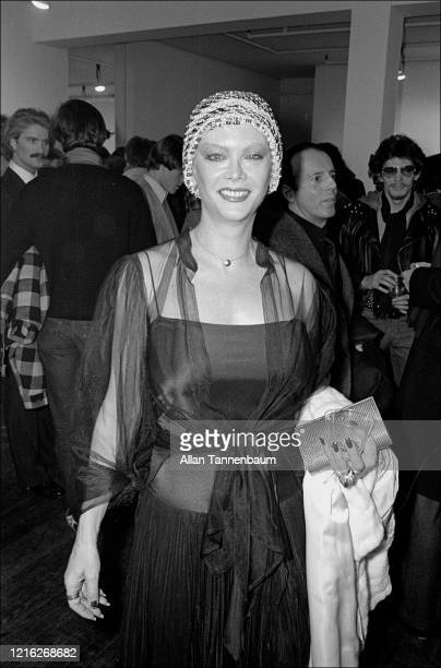 Portrait of Belgianborn American actress Monique Van Vooren as she attends an art opening at the Castelli Gallery New York New York January 11 1977