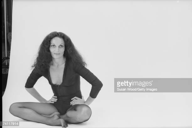 Portrait of Belgianborn American fashion designer Diane von Furstenberg as she sits crosslegged on the floor with her hands on her hips June 16 1977