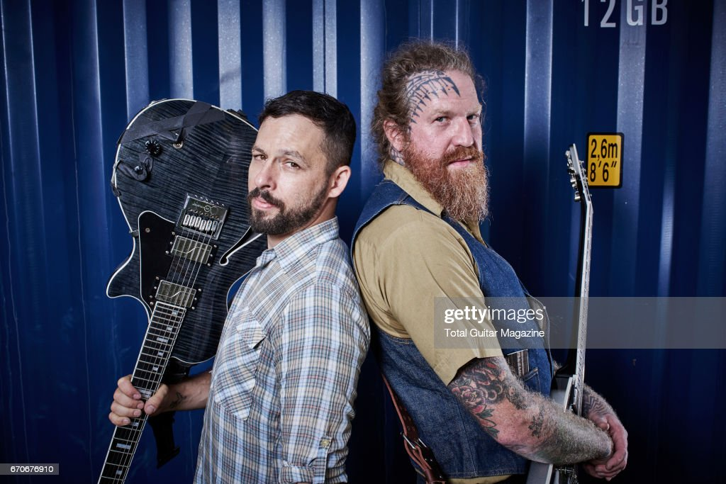 Portrait of Ben Weinman (L) and Brent Hinds, guitarists with hard rock group Giraffe Tongue Orchestra, photographed before a live performance at Reading Festival on August 27, 2016.