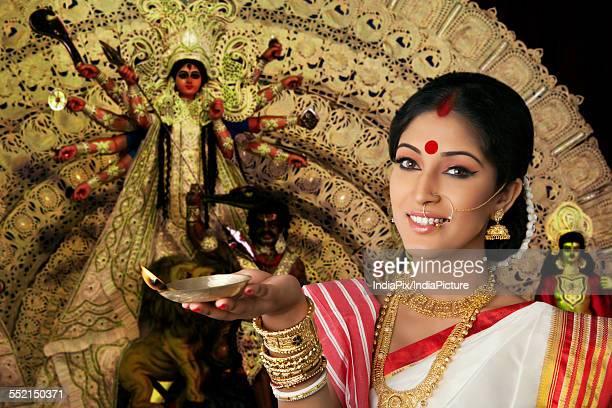 Portrait of Bengali woman holding a diya