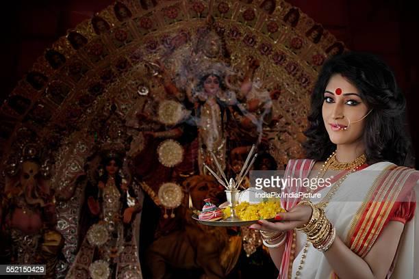 Portrait of Bengali woman holding a puja thali