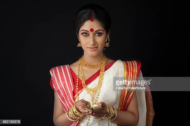 Portrait of Bengali woman with diya