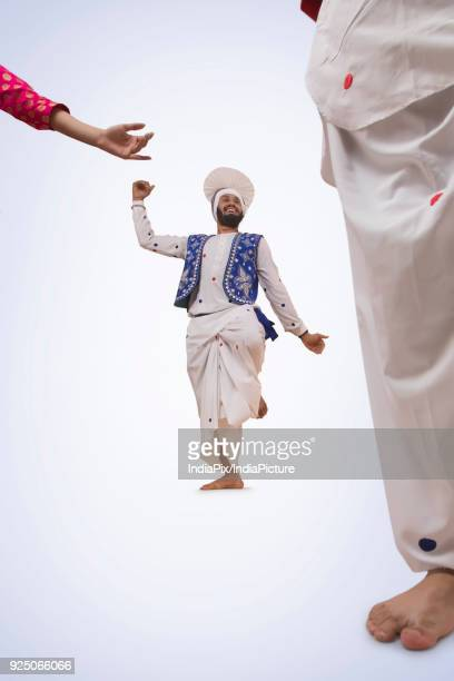 portrait of bhangra dancers - lohri festival stock pictures, royalty-free photos & images