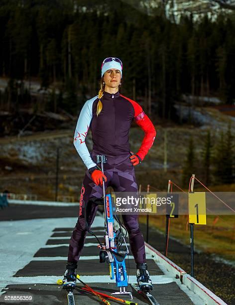 portrait of biathlon athlete at firing range - damen biathlon stock-fotos und bilder