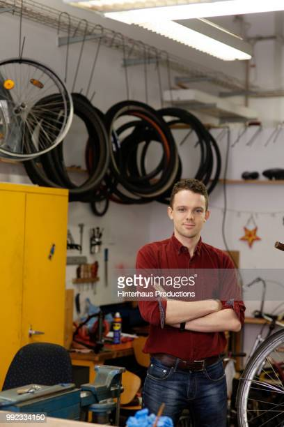 Portrait Of Bicycle Technician In Workshop