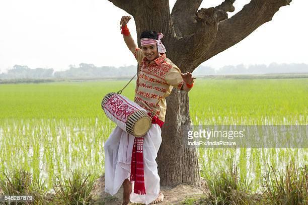 Portrait of Bihu man playing on a dhol